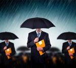 businessmen in rain igor fotolia com